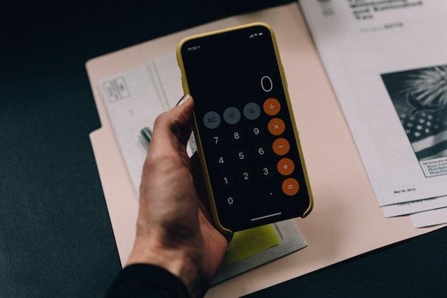 Person using calculator on smartphone