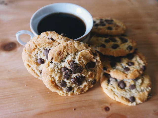 Pile of cookies resting near coffee cup