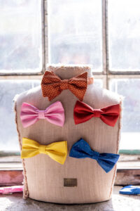Mannequin with bow ties pinned on