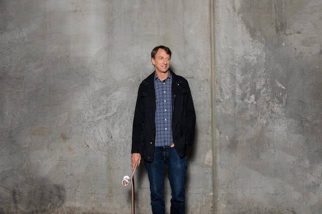 Tony Hawk posing with skateboard