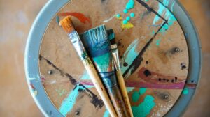 Dirty paint brushes resting on tray