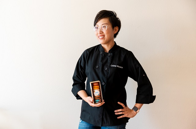 Anita Lee of Colette Macaron posing with cookies in a box