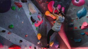 Rock climber assessing their next move upward
