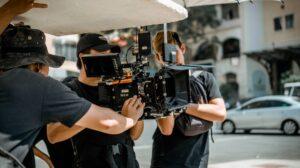 Three men working on a movie set