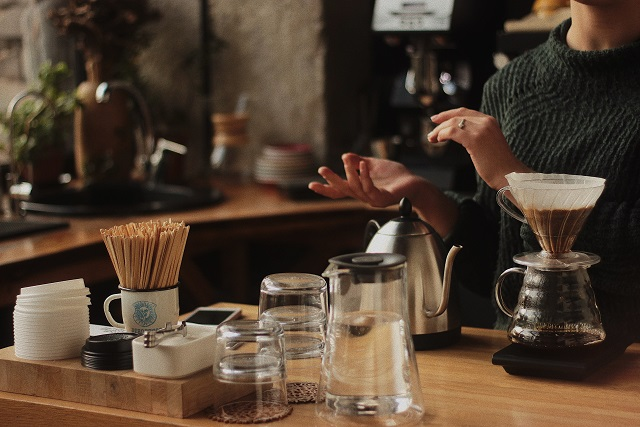 Barista with a pour-over brewer