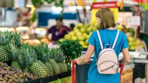 Woman in grocery store reviewing her options