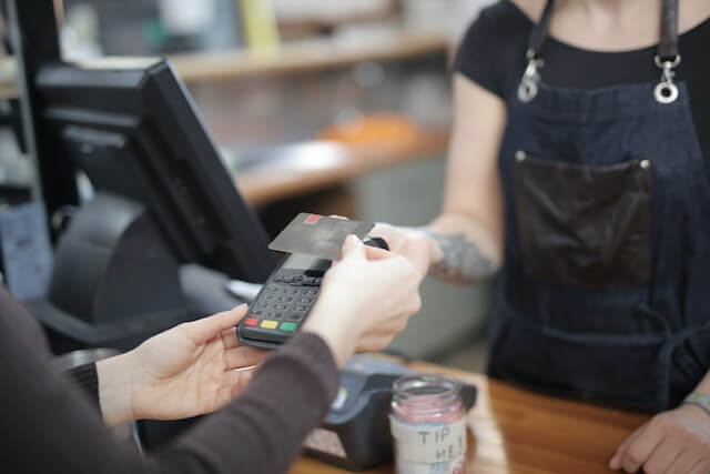 Person paying in store with a credit card