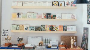 Stationery store display with cards on shelves
