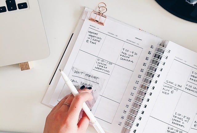 Open Planner With Calendar And Pen