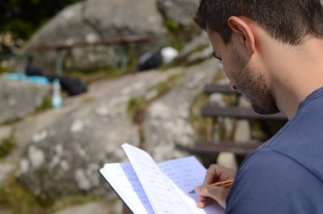 New Year's Resolutions Entrepreneurs Man Writing In Notebook