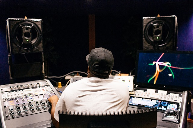 Man Mixing Audio With Soundboard
