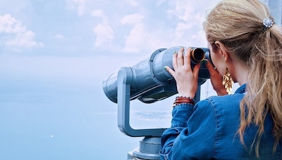 Woman Looking Through Binoculars Represents Scoping Out Competition