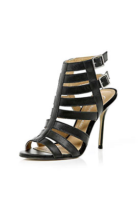 (7) Cage sandals are the perfect shape for most dresses this season. Black caged sandal £55 from River Island