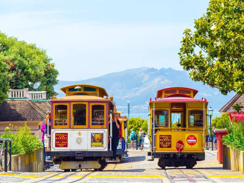 San Francisco, USA - May 19, 2016: Tourists wait at terminal cable car turnaround station, the end of the line at Hyde Street, Fisherman's Wharf with Marin Headlands in background. Horizontal