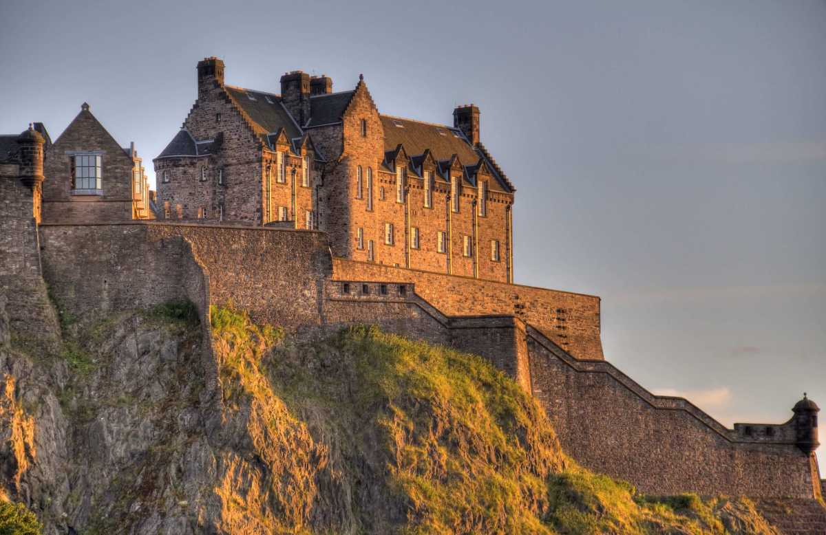 Edinburgh Castle on Castle Rock in the light of the setting sun