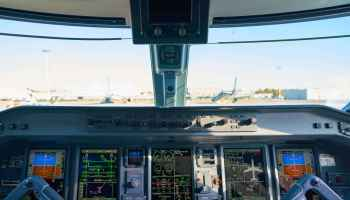 LINATE, ITALY - CIRCA NOVEMBER, 2017: interior shot of Alitalia Cityliner Embraer ERJ-175STD cockpit.