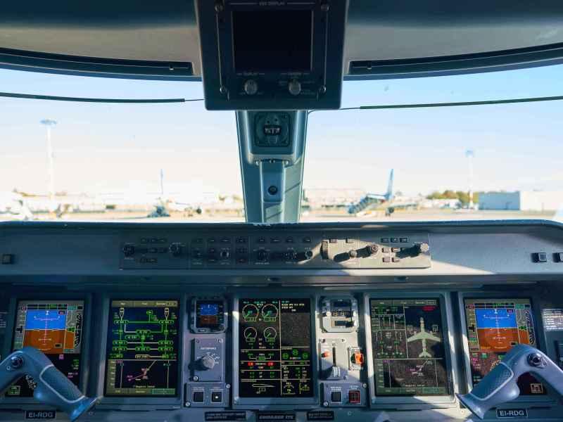 LINATE, ITALY - CIRCA NOVEMBER, 2017: interior shot of Alitalia Cityliner Embraer ERJ-175STD cockpit.