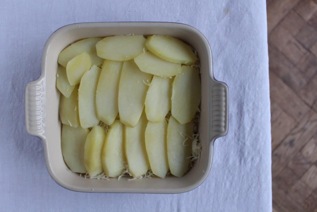 gratin van aardappel en aardpeer goestjes