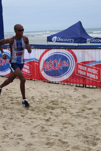 CONQUEROR: First-time winner of the 11.2km race, Bulelani Mgubo, makes it to the finish line at the Discovery Surfers Challenge Picture: SIVENATHI GOSA