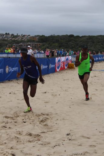 CHASING SUCCESS: Winner of the main 17.5km event, Vusumzi Zondo, charging for the finish line as he leaves the defending champion, Siviwe Pati, behind Picture: SIVENATHI GOSA