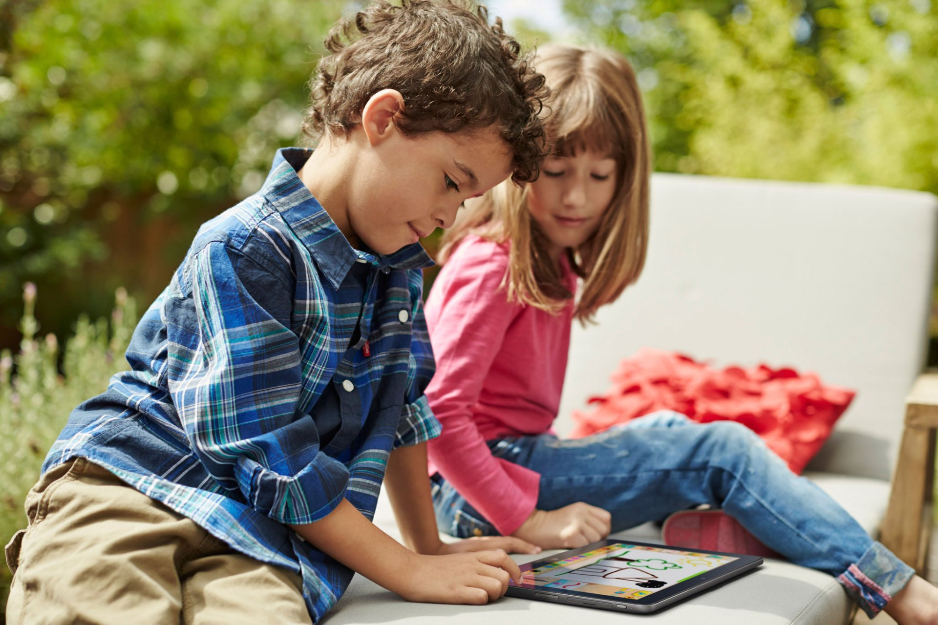Two Children Using Venue 11 Pro 7000 Series Windows Tablet