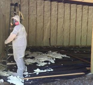 Spray foam insulation in progress
