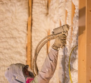 Applying the spray foam insulation.