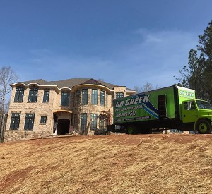 Go Green Spray Foam Truck by house