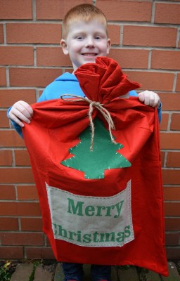The Christmas Boutique - Large red felt sack