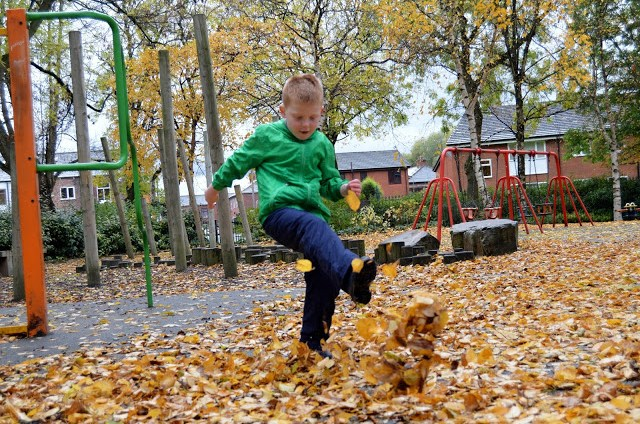Kicking leaves in Muddy Puddles Puddlefleece Trousers