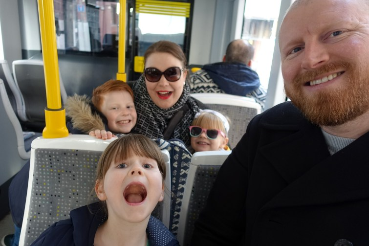Ordinary Moments - half term, family on tram