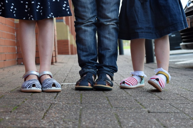 Kids wearing Bobux sandals