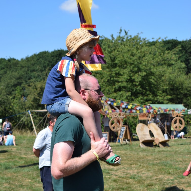 Timber Festival - little girl on her daddy's shoulders