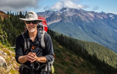 Travel heart health benefits hiking retiree 710x450