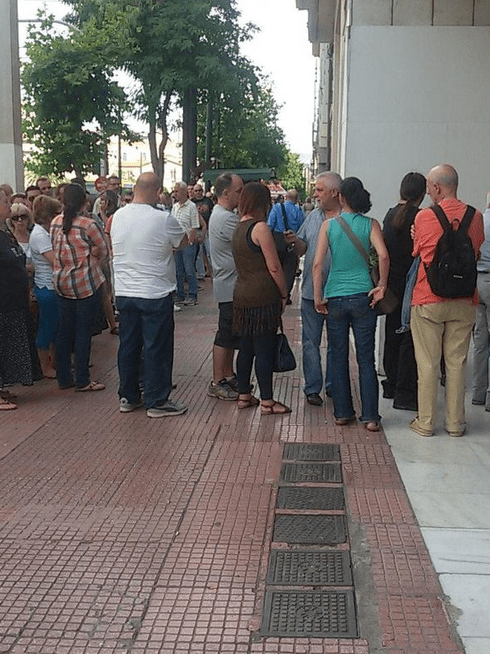Greeks line up to an ATM in a run on Greek banks