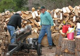 firewood volunteers splitting wood near nevada city