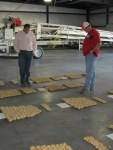 Weston Walker and Corey Thompson of Basin Fertilizer look at chipping potato varieties