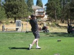 Bart Crawford demonstrates a beautiful golf swing on the Running Y Ranch's Arnold Palmer designed golf course.