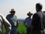 Bill Walker and growing partner Matt Huffman talk about chipping potatoes with guests at the Running Y Ranch.