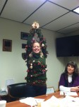 Necia Phillips showing off her ugly Christmas sweater at the Gold Dust office in Malin, Oregon.