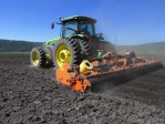 A tractor pulling a Salford tiller breaks up clods in a future potato field at the Running Y Ranch, Klamath Falls, OR.