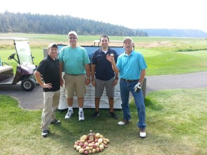 A team photo of Darcy Hill, Mike Delisle, Emmanuel Rios and Matt Huffman at Gold Dust Potatoes' 2013 Open House Field Day.