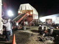 Cellar crews unload shipping potatoes at night into a cellar located outside of Malin, OR.