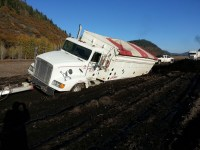 A loaded spud truck sunk in a soft spot in a chipping potato field on the Running Y Ranch.