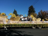 The Gold Dust Potatoes office staff and children pose on their Klamath Basin Potato Festival float prior to the parade's start.