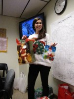 Lexi Crawford handed out Secret Santa gifts at the Gold Dust Office Christmas Party.