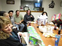 The Gold Dust office staff opening Secret Santa gifts at their staff Christmas Party.
