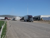 A potato trucks leaves Gold Dust Potato Processors in Malin, OR, to get another load of chipping potatoes.