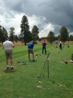 Guests of Gold Dust's Open House Field Day hitting balls at the golf range at the Running Y Ranch resort.