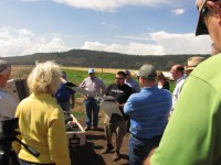 John Faus of HoneyComb talks to Gold Dust and Walker Brothers' guests about their latest agricultural UAV at the Running Y Ranch during Gold Dust's 2014 Open House Field Day.